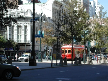The newly revived Canal Streetcar makes its way down the famous Canal Street in New Orleans.